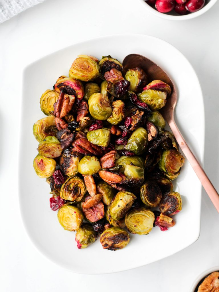 These easy balsamic roasted Brussels sprouts with pecans and cranberries are crispy and flavourful with an added crunch. Perfect for a healthy meal or holiday gathering. The ultimate vegan and gluten-free vegetable side dish!
