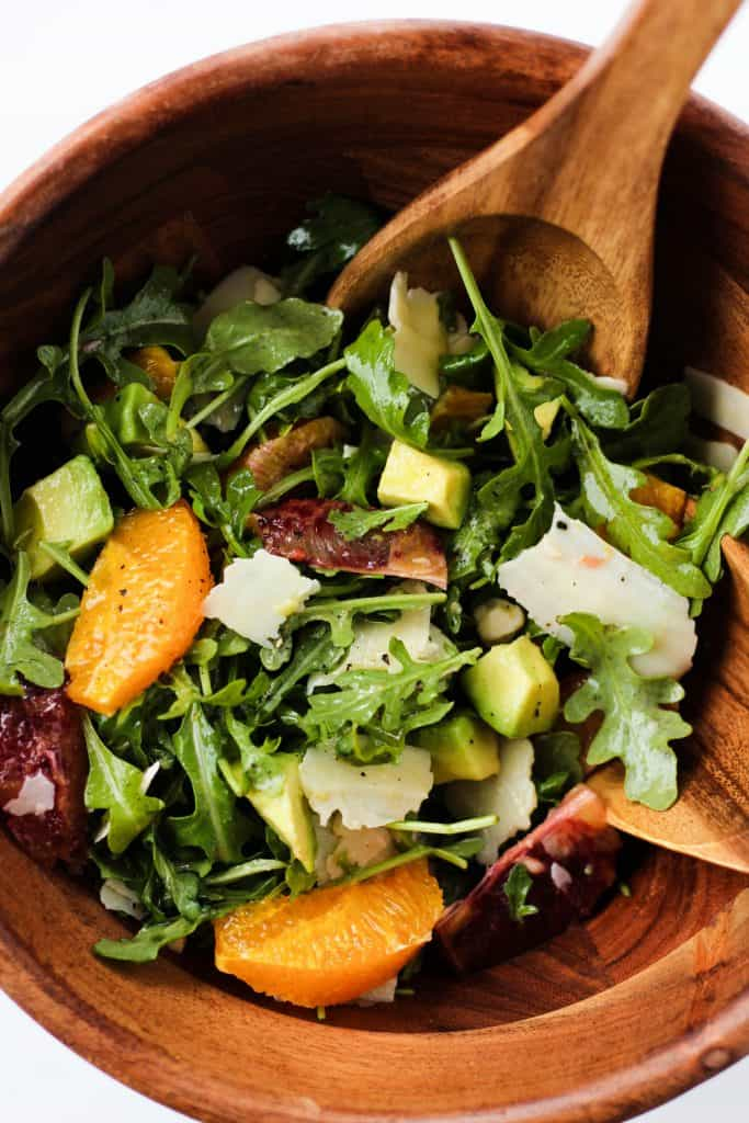 This healthy, easy Citrus Arugula salad makes a delicious lunch or side dish to pair with whatever you're cooking for dinner. The sweet citrus pairs so well with the crisp arugula, sharp parmesan cheese and buttery avocado. The dressing is a light Lemon Honey Vinaigrette.