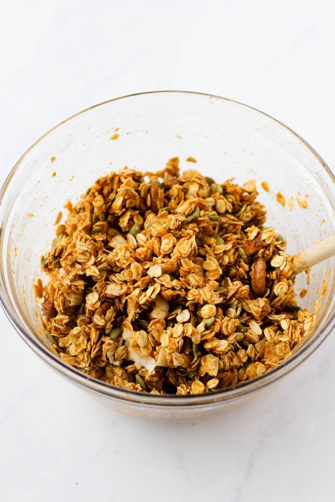 Mixing pumpkin granola ingredients