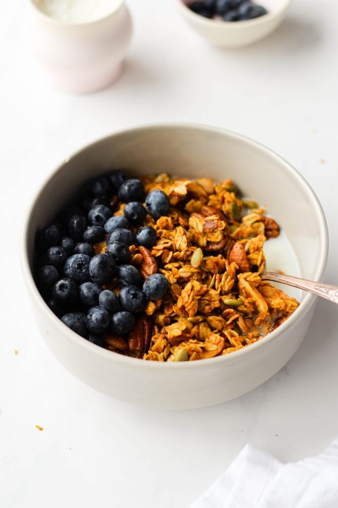 A healthy vegan pumpkin granola recipe that's easy to make, vegan and gluten-free. You'll never want to buy store-bought granola again!