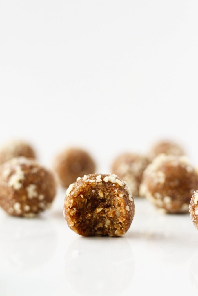 Salted Caramel Apple Energy Balls made with healthy ingredients like dates, oats, walnuts, and applesauce. They taste like caramel apples in energy ball form!