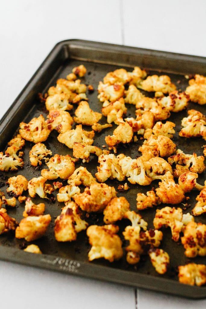 curry roasted cauliflower on a pan