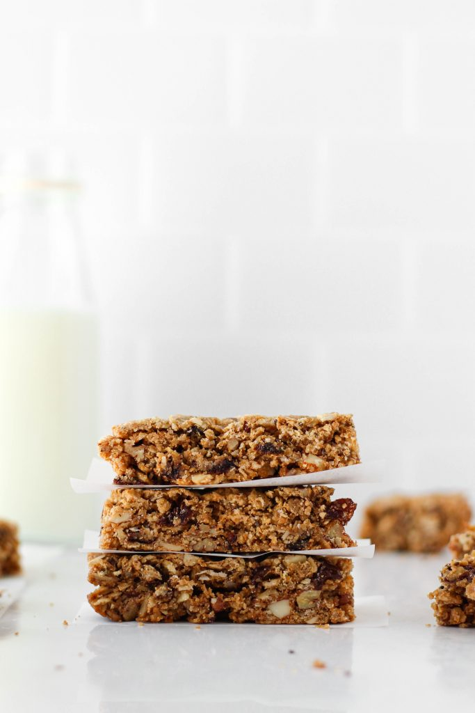 These homemade vegan granola bars are the perfect healthy snack to keep on hand. Packed with oats, peanut butter, nuts, seeds, dried fruit, and chocolate - what's not to love?