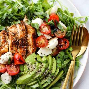 Simple and incredibly flavourful Chicken Avocado Caprese Salad with Olive Oil and Balsamic Glaze. Makes an easy and healthy meal!