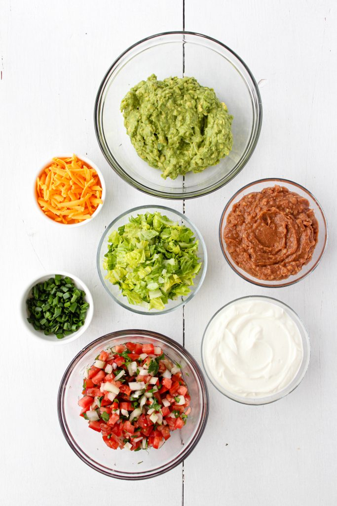 Recipe ingredients laid out in bowls.