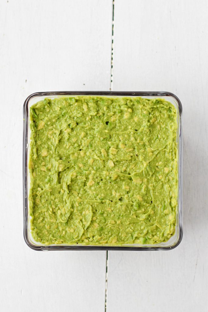 Guacamole layer in a pan.