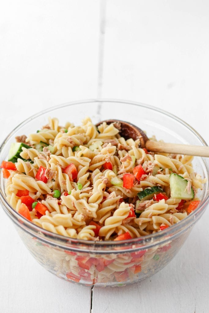 Large bowl with rotini, chopped vegetables, and tuna mixed together.