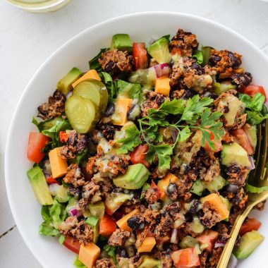 This Veggie Burger Salad has everything you love about a good burger, just without a bun! Lettuce, tomato, onion, avocado, pickles, cheese and the veggie burger, finished off with a deliciously easy dressing. This recipe is vegetarian and gluten-free!