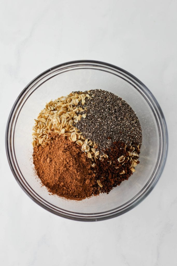 Mocha overnight oats dry ingredients together in a bowl.