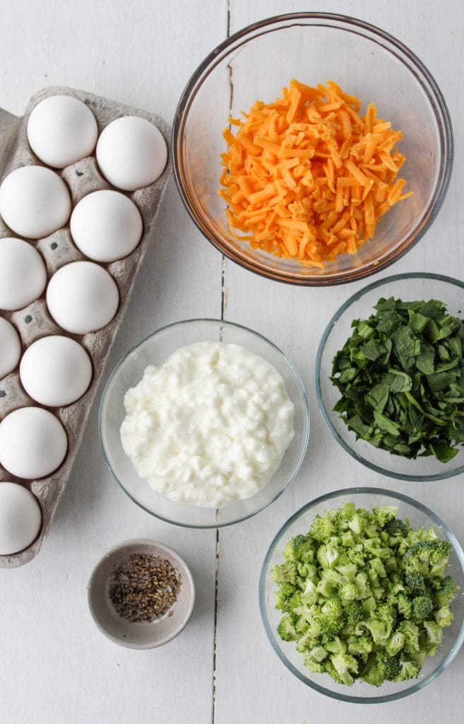 Ingredients for broccoli cheddar baked egg bites: eggs, cottage cheese, salt, pepper, cheddar cheese, chopped broccoli and chopped spinach